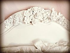 Headboard applique how to. The floral appliques are at www.doityourselfchic.com. It took me forever to find the link.