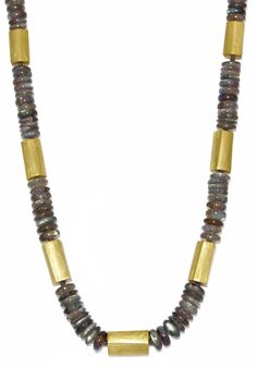 Catherine Mannheim necklace of labradorite beads, interspersed with yellow gold textured cylindrical spacers (£POA).