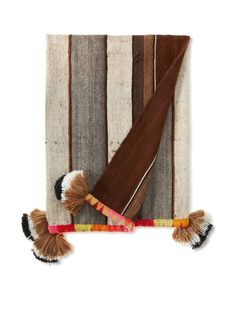 Nomadic Thread Society Pisac Manta/Throw, Multi Sewn from discarded grain sacs and finished off with a colorful hand woven border and pom pom accents, accent your décor with nomadic throw Care instructions: Dry Clean Country of origin: Peru Fabric: 100% Alpaca Wool