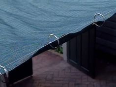 Learn how to make and install a retractable patio shade screen, including details on working with shade screen, grommets, and wire cable.
