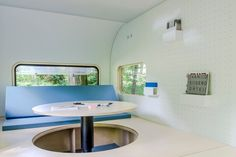 The table in the dojowheels mobile office rises up from the raised floor