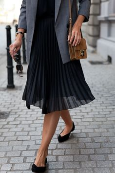 Sheer Pleated Skirt, Camel bag & Black flats.