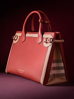 99002f640b9f The Burberry Banner Bag features a softly structured design with equestrian-inspired  buckle fastenings.