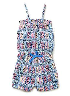 Cotton/Elastane blend Playsuit. Jersey playsuit with knitted shoulder straps, shirred top and elasticised waist. Features all-over multicoloured aztec print. Available in colour shown.