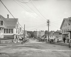 "Circa 1907. ""Street in Lakeport, New Hampshire."" Points of interest in this view of the fair city (last seen here) include the Lovejoy & Prescott fire insurance agency, Adkin & Adkin Millinery, the L.E. Pickering restaurant, Frank Clow Wood & Coal (""Hard, Soft, Bobbin & Slab""), W.A. Moore Boots & Shoes, and a lady having a conversation with her horse. Not pictured: sign painter with a graduate degree in ampersands. 8x10 glass negative, Detroit Publishing."