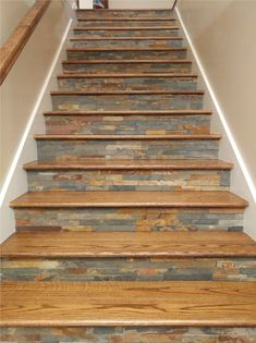 Tiled staircase - ledger slate. We just designed and built this staircase about a month ago! It turned out gorgeous.