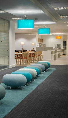 Shade of Blue >> Circular Ottomans >> These round blue and turquoise foot stools look great against turquoise drum lampshades and duck egg blue carpet. The stools provide a perfect alternative seating arrangement when there is no space in the adjacent meeting rooms. See more of this office design and build project in Newcastle on our website...