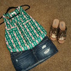 Top Summer waist length top cute with skirt or Shorts. Size large. Fabric is polyester Tops Tank Tops