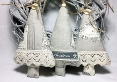This set for those who want to decorate for the season with a comfortable country touch. Set of tree fabric trees is embellished with natural jute string with buttons and cotton lace on the front . Other ornament with Merry Christmas ribbon tag on it. Each tree has hanging loop is made of natural jute string with wooden beads. Measures approx .15 cm by 10 cm Will arrive packaged in a cello bag ready for gifting.  Please feel free to message me with any questions.