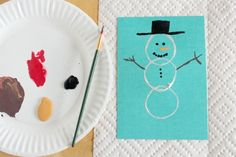 Toilet paper roll stamped snowman