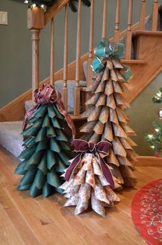 Paper Cone Tree: cardboard tube, from center of wrapping paper roll or use paper towel tube for shorter tree, wrapping paper, or scrapbook paper in patterns/colors of choice, tape, scissors, ruler