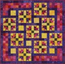 Blocks are made in three rows (two wide and one narrow), which are not joined until you sew the wide and narrow rows of the quilt together. Easy! No set-ins or partial seams. Grandma's Scrapbook, designed and pieced by Judy Martin for her book, Scraps.