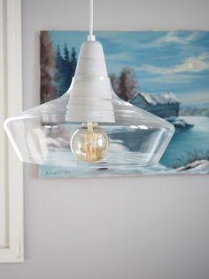 Glass shade of Laaka pendant lamp lets the nature breathe in the room. Laaka pendant lamp designed by Laura Väre   #sessakdesign #sessaklighting #finnishdesign #lighting #Nature #Scandinavian #scandinaviandesign #concrete