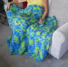 """Lovely Soft Chunky Knitted throw/blanket that measures 58"""" X 44"""" approx  Vibrant coloured. Wool mix yarn      As with all hand knitted items true measurements are difficult and each piece is individual so no 2 items will be exactly the same.        Wash at 30 degree on delicate cycle or hand wash. Dry flat, do not iron or tumble dry. Can be dry cleaned.    Great for Children's bedrooms and playrooms.        This item comes from a smoke and pet free home.   Shop this product here…"""