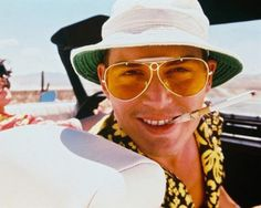 Pin for Later: Johnny Depp's Weirdest and Wackiest Movie Looks Fear and Loathing in Las Vegas Depp rocks a white sailor's hat and some serious sunglasses for his drugged-out Vegas adventure.