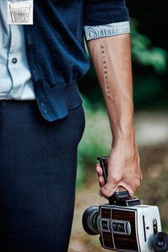 """A really nice and simple forearm tattoo with a literary French expression of """"Joie de Vivre"""" meaning exuberant enjoyment of life."""