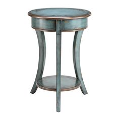 Incorporate a sense of rustic charm into your home decor with this pleasant accent table. Finished in a bright aged blue, this vintage style, bronze-rimmed table is sure to add the pop of color that your living room needs.