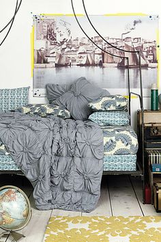 the duvet and mix of sheets on the box springs, mattress and pillows call to me. Love the different patterns and textures!
