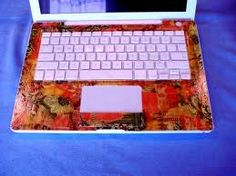I love decopatch, but I'm not sure my family would talk to me if I did this to our laptops. :) Brilliant Idea :D