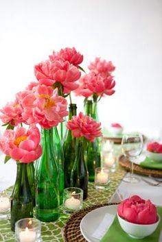 Love these pink flowers with the green bottles- but would totally do this with blue bottles and orange flowers!!