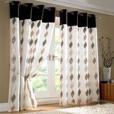 Wave Pair of Lined Voile Ring Top Curtains in Chocolate