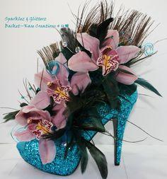 "Shoe flower arrangement- Sparklez & Glitterz.. 5"" Turquoise Glitter heel with pink Cymbidiums, Peacock & feathers & rhinestones."