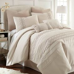 Lend an understated pop of pattern to your master suite or guest room with this lovely, light weight comforter set, showcasing a trellis-inspired motif in cr...
