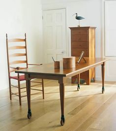 Wheeled Shaker Table With Ladder Back Chair.