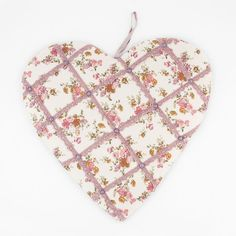 Heart shaped notice / pin board  - Sass & Belle pink pinboard that measures approx 41cm x 41cm. The heart has a cream fabric with pink & purple floral pattern which has been finished off with pink lace style ribbon and pins at points to give it it's vintage look. To the rear there are two metal hoops to hang and to the top there is a further ribbon to give you a choice of hanging methods.
