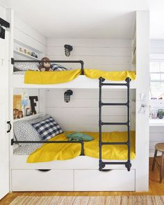 These bunk beds include shelving, storage, and secret hiding nooks for treasures. The railing and ladder are made of inexpensive gas pipe.