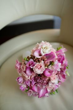 A soft bridal bouquet of varying shades of pink. Pink calla lily, pale pink spray roses, pink celosia, white roses and pink fresia. So pretty!