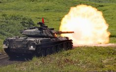 A Type 74 armoured tank fires during the annual training session