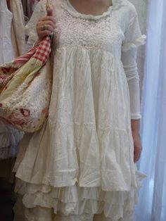 BULGANE: UN PEU DE DENTELLE.....Notice the long sleeve top of same color worn under the dress