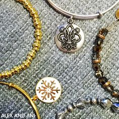 ALEX AND ANI Fleur De Lis Charm Bangle | Associated with the Holy Trinity, the Fleur de Lis represents faith and life. In ancient texts it was a symbol of the eternal flames of the heart: love, wisdom, and power. Let the Fleur de Lis be your three-part reminder of the divine fire within you.