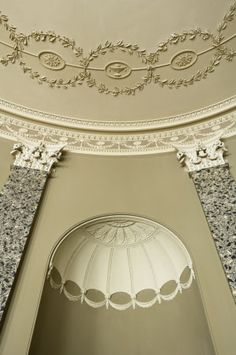 Detail of the plasterwork ceiling by Joseph Rose and shell-shaped niche mouldings between the Corinthian grey scagliola pilasters in the Saloon at Castle Coole, Enniskillen, Co Fermanagh