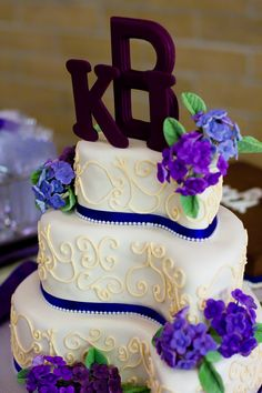 I LOVE our paisley shaped wedding cake with a  monogram top. :) :) Proud to call it mine!