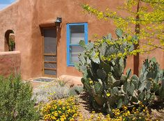Love the turquoise accents on the terra cotta stucco.