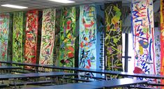 """Kg Kandinsky Murals:  Each class produced a mural. Each student cut organic and geometric shapes and assembled them into one interesting piece by arranging and overlapping. Each student then glued his shape to the mural. Students took turns painting """"dancing lines"""" around the shapes."""