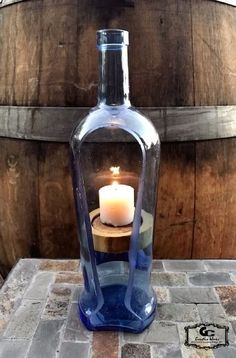 Sanctuary Candle Holder bottle crafts with candles Wine Bottle Candles, Wine Bottle Art, Diy Bottle, Bottle Lights, Bottle Lamps, Wine Bottle Holders, Vodka Bottle, Recycled Glass Bottles, Glass Bottle Crafts