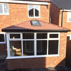 Garden Room Roof for a thermally efficient Conservatory all year round. Finished with red envirotile this is a Conservatory built to last.