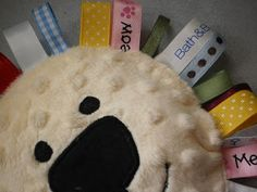 Isn't this a cute baby toy. My sister showed me  this link  and I knew I just had to make one. I have been making little tag blankets f...