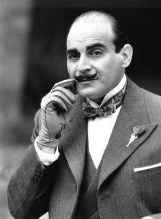 David Suchet as Agatha Christie's detective Hercule Poirot, stroking his moustache in 1988.
