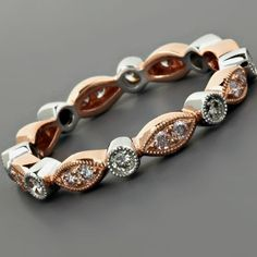 rose  white gold eternity band - This would look perfect with the solitaire Brock got me a couple valentines ago. ;)