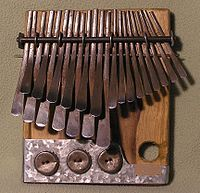 This is the mbira used by the Shona people of Zimbabwe in the Eastern Region of Africa. Used in ceremonies to communicate with ancestor's spirits.