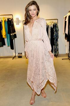 Who: Miranda Kerr What: A Floaty Summer Dress Why: The model brings airy summer vibes in a lightly-hued silk dress by Zimmermann, paired with a clutch by Edie Parker. Get the look now: Zimmermann dress, $895, shopbop.com.