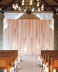 REVEL: Peach Fabric Backdrop  PRICE: $5.45 per yard    DESCRIPTION: Flowers, candles, and fabric strips transformed a spare space and create a stunning backdrop for your alter. Image: Martha Stewart Weddings
