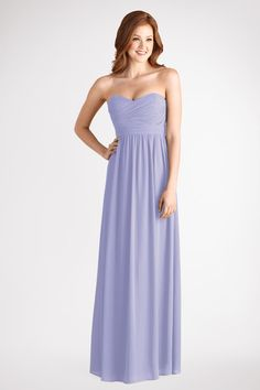 Subtle Ruching Highlights This Flowy Strapless Sweetheart Iris Chiffon Dress With A Floor Length Skirt