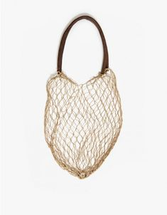 Simple and low-key cotton cord net bag with soft leather handles from And So It Goes. Handcrafted one knot at a time in Los Angeles.   •Hand knotted cotton cord net •Soft leather handles •100% Cotton •Leather handles •Made in USA