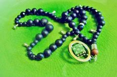 Men's dark and beautiful smoky bead necklace with a little touch of shine to brighter and match your wardrobe.