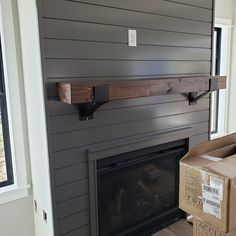 Dress up your fireplace with shiplap. Also, shiplap is a great backdrop for your fireplace mantel and decor. Turn the ordinary into extraordinary. Fireplace Tv Wall, Brick Fireplace Makeover, Shiplap Fireplace, Fireplace Remodel, Fireplace Surrounds, Fireplace Design, Fireplace Ideas, Basement Fireplace, Black Fireplace Surround